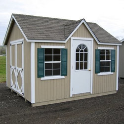 Little Cottage 12 x 8 ft. Classic Wood Cottage Panelized Garden Shed - Additional FeaturesDoor measures 4W x 6H feetFeatures high-quality siding and trimBeautiful gabled frontFeatures aluminum gable ventsDouble side door allows for easy entry and exit With its beautiful gabled front and two windows, the Little Cottage 12 x 8 ft. Classic Wood Cottage Panelized Storage Shed Kit is ideal as a shed, workshop, or even a playhouse for your kids. Crafted from wood, this shed features a steel door with a locking latch, as well as double doors on the side to easily move equipment in and out. With high-quality siding and trim for durability, this shed also has an aluminum gabled vent, and two windows with shutters.About The Little Cottage CompanyNestled in the heart of Ohio's Amish country, The Little Cottage Company resides in a quaint, slow-paced setting where old-fashioned craftsmanship and attention to detail have never gone out of style. Their experienced carpenters and skilled designers take great pride in creating top-quality, pre-built models and Do-It-Yourself kits of playhouses, storage sheds, and more.