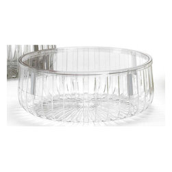 "Kartell - Panier Table - The Panier is distinguished by its simple yet evocative form. The shiny, transparent bars emanating from a central circle recall the rays of the sun, particularly when placed in the light. Its structure consists of four modules which attach by means of a tongue-and-groove and secured with a discreet joint. Made entirely of polycarbonate, the Panier is suitable for indoor or outdoor use and functions as both a container for magazines and supplies or even as a small end table. Perfect for the pool deck, living room or bedroom, the Panier is a useful and playful addition to the home. Features: -Made of transparent polycarbonate. -Can be used indoors or outdoors. -Dimensions: 9"" H x 24"" W. Quality: -In 2005, Kartell received accreditation for its Quality Management Systems according to the ISO 9001: 2000 standard. The attainment and preservation of this certification testifies to Kartell's commitment to high quality and continued research into higher levels of quality in company management systems.. Helping the Environment: -Kartell products use a wide variety of plastic materials, thereby reducing the use of living organisms, such as trees, which are difficult and time-consuming to replace.. -Most Kartell products are easily recycled and product components can be separated to elements made of a single material to simplify the recycling process. Plastic components also carry clear identification marks to aid correct separation of different plastic types for effective recycling.. Care and Maintenance: -Kartell products are easy to clean and require only simple care to remain in excellent condition.. Order with Confidence: -Authentic Kartell products are guaranteed to be free from defects in materials and workmanship for a period of 12 months under normal use and under conditions for which the items were designated.. -Should you discover shortly after receiving your Panier that parts are either damaged or missing, please call us immediately, and we will be happy to send you replacement parts as soon as possible and at no additional cost.."