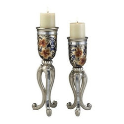 Cherry Blossom Candleholder - Set of 2 - The Cherry Blossom Candleholder - Set of 2 has bold, modern touches that make a designer impact in the home. These Polyresin crafted candleholders feature curvaceous silver bases with mirrored accents with a modern, jar-shaped topper. Golden cherry blossom and silver, feathery leaves are set against a midnight blue background. Comes complete with two white, vanilla scented pillar candles.About Ore International, Inc.Ore International, Inc. creates beautiful accent furniture, lighting, and gifts for the home. Their goal is to be the leading provider of innovative, superior home products worldwide. Ore International is based in Santa Fe Springs, California and has a Customer First attitude. Their products are designed to match modern and classic tastes and fit today's homes. From room dividers to lamps, end tables to entertainment centers, you'll discover quality craftsmanship at a fair price in all Ore International products.