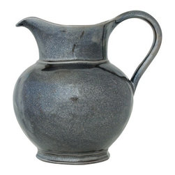 "Juliska - Juliska Pewter Stoneware Round Pitcher - Juliska Pewter Stoneware Round PitcherCool shade of luminous grey begs for this graceful pitcher to be filled with refreshing drinks or armfuls of flowers in sharp, contrasting hues like stark white daisies or vibrant dahlias. Dimensions: 8"" H Capacity: 2 Qt"