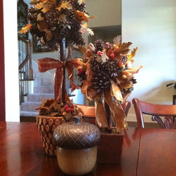 fall decorating - Fall topiaries and an over sized acorn grace the dining room table for the fall.