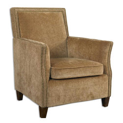 Uttermost - Amani Sculpted Reptile-Look Fabric Armchair - If  you  have  been  looking  for  a  rustic  armchair  with  clean  lines  and  a  unique  design,  this  may  be  the  perfect  fit.  Neutral-toned  fabric  is  in  a  sculpted  reptile  design,  accented  with  two  rows  of  brassy  upholstery  tacks.   Cushion  and  back  are  a  coordinating  creamy  flax  hue,  and  hardwood  legs  are  stained  light  walnut.   The  naturally  clean  profile  that  will  work  well  with  many  different  styles  of  decor  and  tonal  themes.  Back  and  arm  supports  are  sturdy,  with  a  clean,  chic  feel.  Matching  Ottoman  also  available.                           The  Amani  Armchair  is  available  with  a  matching  ottoman.  Click  image  above  to  purchase  ottoman.