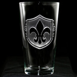 Crystal Imagery - Fleur De Lis Engraved Pint Pub Glasses, Set of 4 - Fleur de Lis pub glasses, pint glasses, engraved with the popular French Fleur-de-lis are a unique gift for the Francophile who loves french decor. Our Fleur de lis engraved water glass or beer glass features an old world European shield background carved out from the glass by our master glass carvers to leave the fleur de lis boldly raised from the pub glass surface in a stunning 3 dimensional manner. A great wedding gift, anniversary or birthday gift idea for someone with French heritage or who loves French decor or French Country decor. Our French bar glasses and French barware are a gift that will make jaws drop and will be used and appreciated for many years to come.