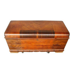 Used Lane Art Deco Waterfall Cedar Chest - This sophisticated Art Deco period cedar lined chest circa 1940 is beautifully detailed with diagonally matched walnut and burl, zebra wood and mahogany. The finish is in very good condition with damage to the lower part, where it touched the ground.     This bench height vintage cear chest has a lot of life left in it and will continue to serve as an heirloom piece.Inside is a tray that opens as the lid is raised. The metal bars that hold the lid open are missing the attaching screws but could be easily fixed.    A rare opportunity to get an amazing deal on a real soldier of an heirloom.