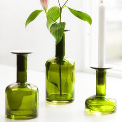 Inkwell Taper Holder in Green - This innovative, multi-purpose glass candle holder magically becomes a bud vase when you remove the aluminum insert from its neck. Mouth-blown glass forms this architecturally fanciful mid-century modern design, as candle holder morphs to vase, and back again.