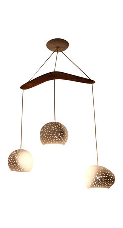 "Lightexture - ClayLight Boomerang X3- chandelier - Three ceramic shades hang from a 16"" Australian brigalow wood boomerang to create a mobile of lights, textures and shapes in this chandelier"