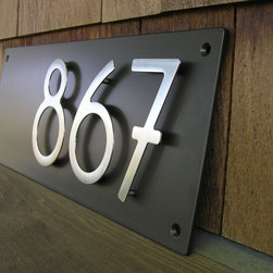"""Dark Bronze Contemporary Address Plaque - This is a new product we're offering, measuring 18""""long x 7"""" high x 3/16"""" thick. Your three-digit address sits aligned to the right for a contemporary twist on address plaques. You choose the finish for the plaque and for the numbers. Plaques arrive completely assembled; all you need to do is install it to your preferred location."""