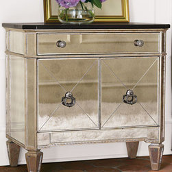 "Two-Door Mirrored Chest - Add a touch of glamour and glitz to an entry hall, living area, or bedroom with this two-door mirrored chest. Made of hardwood with mirrored veneers on front and sides. 30""W x 17""D x 29""T."