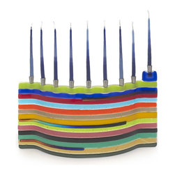 Fused Glass Menorah - Add some color other than the normal blue and silver to the holiday decor with a fused glass menorah from Tamara Baskin. Inspired by Jacob's technicolor dream coat, this menorah will add pizzazz.