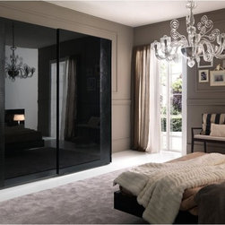 Rossetto USA - Rossetto USA Nightfly 95 in. 2 Door Sliding Wardrobe - Ebony - T412030121003 - Shop for Closet from Hayneedle.com! The Rossetto USA Nightfly 95 in. 2 Door Sliding Wardrobe - Ebony is a sophisticated bedroom piece with built-in accent lighting and a contemporary elegance that is unmatched. You won't find another piece quite like this wardrobe which was designed by Italian craftsmen from hardwood solids and veneer that's been given a glossy lacquer finish that's smooth to the touch and pleasing to the eye. Crocodile leather embellishments are used all around the borders for a look that will always amaze and never go out of fashion. Its two sliding doors glide open effortlessly to expose a deep storage space that gives you plenty of room to hang all of your garments and even an overhead shelf that's perfect for hats shoes and whatever other treasures set aside for a special occasion. Measures 27W x 95D x 93H inches. Some assembly is required.About Rossetto USA Rossetto USA is the U.S. division of the Arros Group a leading manufacturer that exports Italian furniture style and design all over the world. Operating out of its warehouse in High Point N.C. since 1999 Rossetto provides complete contemporary and modern dining bedroom and occasional furniture programs that combine affordable price with innovative Italian design to satisfy the demands of their distinguished customers.