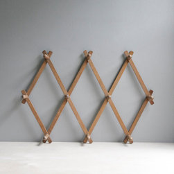 Classic Wood Peg Rack by Oh, Albatross - This vintage coat rack is a real classic, and its profile is slim enough for a tight space.