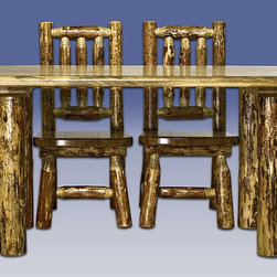 "Montana Woodworks - Glacier Country Child's Log Table - Compliments nicely with log chair - Chairs NOT included. 20-year limited warranty. Made from solid, American grown pine. Hand-crafted in the US, each Montana Woodwork product is made from unprocessed, solid wood that highlights the character of its source tree with unique knots and grains. Made in USA. No assembly required. 40 in. W x 20 in. L x 22 in. HYour child will have lots of fun with this rustic log table. Play and craft time was never so good! Combine the table and two or more chairs for a delightful play set that your child can pass on to his or her own children. Finished in the ""Glacier Country"" collection style for a truly unique, one-of-a-kind look reminiscent of the Grand Lodges of the Rockies, circa 1900."