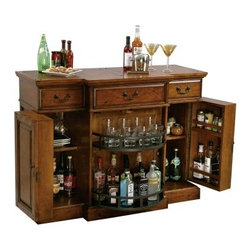 Howard Miller Shiraz Bar - The Shiraz Hide-A-Bar console features an elegant Indian Summer finish on select hardwoods and veneers. This raised door panel cabinet offers generous room for wine and spirits. Each side features an adjustable shelf and storage on the inside of each door. In the center of the console is a Lazy Susan-style pivoting door with two fixed shelves providing additional room for bottle and glass storage. The top surface has a planked style look with a hand planed surface and various forms of distressing. Three upper drawers hold serving utensils, bar cloths and other items.Additional features of this bar include:Hanging stemware rackPad-Lock™ metal shelf clipsLocking doors on both side cabinets and the center pivoting cabinet keep wines and spirits secureAdjustable levelers under all cornersThe Howard Miller StoryIncomparable workmanship, unsurpassed quality, and a quest for perfection - these were the cornerstones of the company Howard C. Miller founded back in 1926, at the age of 21. Even then, Howard Miller understood the need to make products that would be steeped in quality and value.In 1989, Howard Miller began creating collectors' cabinets with the same attention to detail and craftsmanship inherent in their clock-making. Fashioned from glass and hardwoods, Howard Miller cabinets are ideal for displaying heirlooms, plates, glassware, and other collectibles.A highly respected brand, Howard Miller maintains its popularity because of the company's commitment to quality. Every product manufactured at the company's sprawling facility in Zeeland, Michigan, undergoes stringent tests and exceeds industry standards to ensure a lifetime of enjoyment.