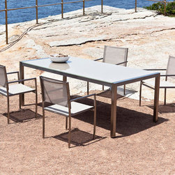 Harbour Outdoor - Soho Glass Dining Set - Sleek and minimalistic, yet still brilliant in its modern, sophisticated beauty, the SohoGlass Dining Set by Harbour Outdoor is the perfect high style, low maintenance outdoor dining set for busy, tastemaking lifestyles. As visually stunning by the pool, on the deck, or in the middle of an empty beach, the modern outdoor dining set includes six outdoor armchairs with stainless steel frames and incredibly durable, UV and mold resistant, colorfast and quick drying, Ferrari of France designed, Batyline mesh, and a sleek, modern, outdoor glasstable. Durable enough to host a sloppy joe eating contest in a hailstorm, and sophisticated and stylish enough to walk the red carpet at the Met, the sleek, elegant, and modern Soho Glass Dining Table by Harbour Outdoor is the perfect outdoor dining table for busy people on the go who refuse to compromise on quality and style. Sleek, clean, modern lines make up the stainless steel frame that seamlessly blends into the tempered glass top. This modern outdoor dining set is the ideal outdoor centerpiece to build your outdoor furniture decor around.