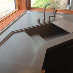 VC Studio Inc. - Integral Concrete Kitchen Sink - This kitchen sink was a new custom design created by VC Studio Inc. It includes an integral drainboard with rails for a sliding cutting board.