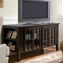 Paula Deen Home 62 in. Entertainment Console - Tobacco - Casual, sophisticated style and smart storage come home with the Paula Deen Home 62 in. Entertainment Console - Tobacco. This entertainment console has laid-back Southern style and is made of select hardwoods and cherry veneers in a dark tobacco brown finish that accentuates the four framed, paned glass doors and decorative hardware. Adjustable shelving behind the doors and display storage at either end gives plenty of room for all your media needs while the built-in power outlet and cord management grommet at the back keeps things charged up and tidy. About Universal Furniture InternationalRecognized as a leader in exceptionally crafted home furnishings, including bedroom and dining room items, entertainment centers, and more, Universal strives to make items that are styled to endure but always remain fresh. They make it a goal to include features that fit the way their customers live today, and to find prices that put high-quality products within reach. These are the principles that guide the work at Universal, essential elements of good, affordable, and smart design.