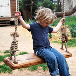Repurposed Tree Swing - Here's a great way to recycle: repurpose a pine floor joist from a 19th-century house as the perfect swing for your yard. Handmade in Pennsylvania, the tree swing encourages kids and the young at heart to let loose and have a little fun in the outdoors. The seat is finished with natural tung oil, and each side comes with 25 feet of manila rope with a 695-pound tension limit. Expect a lot of squeals and laughter with this in your yard!