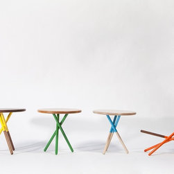 Soft Side Table - These side tables were designed specifically to feel modern, but also to be welcoming and accessible. The color feels playful. You don't always associate modern design with nature and organic shapes, but, in this case, the design for the table legs was inspired by a bundle of sticks.