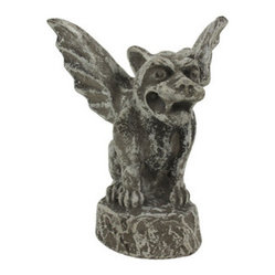 Winged Concrete Baby Growling Gargoyle - In medieval times, ancient architects and stone carvers used gargoyles on buildings as a way to ward off evil spirits and bad luck. Made of concrete, this not-so-scary growling winged baby gargoyle  might ward off evil spirits, neighbors, salesmen and religious zealots. Measuring 6 inches tall, 4 1/2 inches deep, 5 1/4 inches wide, it will look great on your bookshelf, and makes a great gift for family and friends.