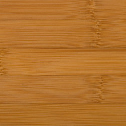 Classic Carbonized Horizontal Bamboo Flooring - The horizontal pattern in this flooring features a wide grain, with clearly identifiable bamboo nodes. This carbonized flooring gets its warm color from a heating process that darkens the bamboo all the way through.