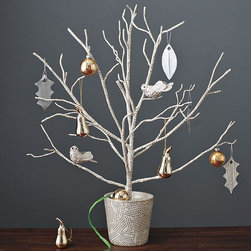 David Stark Twig Topiary - We masses are so lucky that David Starck has a line at West Elm. These twigs wrapped in text are graphic and unique, perfect for someone who likes to decorate for the holidays without clogging up the vacuum with all the pine needles and tinsel.