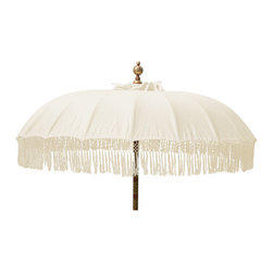 "Natural Fringed Umbrella - Based on a traditional Balinese temple umbrella, this large patio umbrella features charming fringe in a lovely natural cotton. It makes a beautiful decoration and a nice shady spot on a hot day. Fits a standard sized umbrella stand. Dimensions: Diameter 70"" H. 100"""
