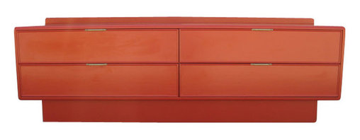 Tables & Case Pieces - The storage unit has four deep drawers with golden hand pulls. This unit sits low and has soft rounded edges mixed with straight lines for a sleek and functional design. - See more at: http://www.galeriesommerlath.com/inventory/cadmium-red-lacquered-low-dresser-by-stanley/#sthash.A1nro65S.dpuf