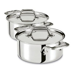 All-Clad - All-Clad Tri-Ply Stainless Steel Cocottes - Set of 2 - E849A264 - Shop for Kitchen and Serving Utensils from Hayneedle.com! Create delicious meals with the All-Clad Tri-Ply Stainless Steel Cocottes - Set of 2. Crafted from durable stainless steel that has been hand-polished this set of Cocottes feature a pure aluminum core for even heating so your food comes out well-cooked every time. Made so it will not react to food and alter its taste you'll love using these gratins to cook and serve your favorite side dishes. Their ergonomic stainless steel handles are comfortable to use and these pans are oven and broiler safe. Additional Features Ergonomic stainless steel stay-cool handles Riveted handles will not come loose Oven and broiler safe About All-CladFounded in 1971 in Canonsburg Pennsylvania All-Clad Metalcrafters produces the world's finest cookware in its Southwestern Pennsylvania rolling mill using the same revolutionary processes that they introduced forty years ago. Today All-Clad is the only bonded cookware that's handcrafted by American craftsmen using American-made metals. Originally founded to meet the highest standards of professional chefs All-Clad has become the premier choice of cookware enthusiasts of all experience levels from world-class chefs to passionate home cooks in everyday American kitchens. The unsurpassed quality and performance of All-Clad cookware is derived from its innovative roll bonding process which uses a proprietary recipe of metals. Cladding is applied not just to the bottom but also up the sides of each All-Clad cooking vessel providing outstanding heat distribution and reliable cooking results. All-Clad cookware is hand-inspected at every stage of the manufacturing process and is famous for the uncompromising quality that's evident in every detail from its impeccable balance in your hand to its meticulous hand-finishing.