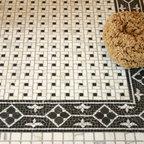 "Frangipani Stone Mosaic - Frangipani 6"" with Cambridge field in tumbled Nero Marquina and Botticino."