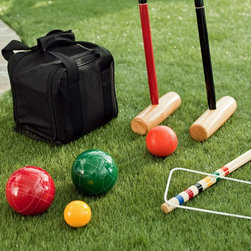 Belham Living - Field Club 110mm Bocce and Croquet Package Multicolor - HKI006 - Shop for Backyard Games from Hayneedle.com! With all the work you put in your lawn you deserve to spend more time on it... without the mower. We can think of no better way to experience the beauty and subtle details of your turf than with the Field Club Bocce and Croquet Package. This package gets you two backyard classics- bocce and croquet- in one affordable package. And these ain't your run-of-the-mill department store sets. The croquet set boasts a vintage design with mallets and goal posts crafted from durable engineered plywood sealed with beautiful hardwood veneers and finished in classic colors to match the poly-resin balls. The bocce ball set features etched red and green bocce balls and a yellow pallino all crafted from durable resin- the most popular material for bocce sets because of its heft resilience and ability to withtstand repeated use. You've walked your yard many times gotten to know intimately every undulation tree root and subtle slope. It's time to put your knowledge to use. There's a reason they call it home field advantage. Croquet Set Details: Finely-crafted with vintage design 3.125-inch poly-resin balls 30-inch wood mallet handles 8.5-inch shaped wood mallet heads Two 8-inch wood goal stakes Vinyl-coated wire wickets to withstand the elements Includes 840-denier nylon carry/storage bag Bocce Ball Set Details: Durable resin balls in classic green and red Etched patterns allow for up to 8 players Yellow pallino for improved visibilty Ball size: 110mm Pallino size: 60mm Includes 680-denier nylon carry bag About Belham LivingBelham Living builds catalog-quality furniture in traditional styles at a price that actually makes sense. By listening to our customers and working closely with great manufacturers we build beautiful pieces worthy of your home. Rich wood finishes attention to detail and stylish lines that tie everything together are some of the hallmarks of a Belham Living piece. From the living room or bedroom through the kitchen and out onto the deck there's something from an incredible Belham collection perfect for your style.