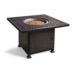 Frontgate - Orleans Fire Outdoor Chat Table, Patio Furniture - Solid cast 100% ingot aluminum with hand-filed welds. Rust-resistant powdercoated frames with UV protected top coat. Gas-powered table (42,000 BTUs). 8 ft. heating radius keeps all guests toasty. 18-hour run time. Enjoy the ambiance and warmth of firelight with our Orleans Fire Table. Equal parts elegance and warmth, the table features built-in fire bowl that dispenses 42,000 BTUs of warmth to those within 8 feet. All this rests on a solid cast aluminum base in a signature Orleans scroll. Part of the Orleans Collection.. . . . . . Fully adjustable flame settings, from low to high. Fuel type: 20 lb. LP gas tank (sold separately). CSA approved for safety. Assembly required; view assembly instructions (PDF format) .