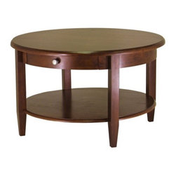 Concord Round Coffee Table - Offset the rectangular shapes of your sofa and chairs with the soft curves of the Concord Round Coffee Table. It features an antique walnut finish for a classic addition to your home's decor. Its traditional style will look great just about anywhere. The coffee table is constructed of durable wood veneers with a drawer and a full-size shelf for storage. Brushed nickel hardware and four tapered legs add to the coffee table's casual elegance.About Winsome TradingWinsome Trading has been a manufacturer and distributor of quality products for the home for over 30 years. Specializing in furniture crafted of solid wood Winsome also crafts unique furniture using wrought iron aluminum steel marble and glass. Winsome's home office is located in Woodinville Washington. The company has its own product design and development team offering continuous innovation.