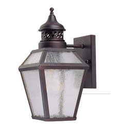 """Savoy House - Chiminea 6"""" Steel Wall Mount Lantern - A New Orleans inspired outdoor style that is destined to become a bestseller, crafted to mimic the appearance of an antique gas lantern. The English Bronze finish and pale cream seeded glass add to the families tremendous value."""
