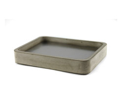 Zeitgeist Factory - Gray Soap Dish - - The Zeitgeist Factory Soap Dish is handcrafted from our proprietary blend of cement and recycled stone dust which is a by product of the countertop industry.- It is designed with a removable modular stainless steel insert which will protect the concrete base for a lifetime. - Stainless steel is dishwasher safe. - A cork base is adhered to the bottom to protect any surface on which it is placed. - Weight: 1lb.