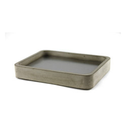 Zeitgeist Factory - Gray Soap Dish - Here's a soap stone that's not soapstone. Each dish is handmade from a blend of cement and recycled stone dust, fitted with a removable steel insert and finished with a cork bottom. This dust doesn't wash off, but it will help you get clean.