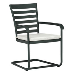 """Orleans Spring Dining Chair with Sunbrella® White Sand Cushion - Elegant French Provencal curves nod to streamlined midcentury modern in this gracious and timeless outdoor collection. Comfortable seating takes shape in durable yet lightweight aluminum tubing, powdercoated in a classic shade of evergreen. Motion """"spring"""" dining chair has a perfectly pitched back and spring base that gently rocks. Slatted design features a softly rounded frame, complete with retro-inspired """"covered"""" armrests. Cushion is covered in fade- and weather -resistant Sunbrella® acrylic in white. Fabric tab fasteners hold cushion in place. Orleans lounge collection also available."""