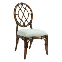 Lexington - Tommy Bahama Home Bali Hai Cedar Key Oval Back Side Chair - The oval back side chair features a leather wrapped rattan frame, comfortable upholstered seat and a leather wrapped bent rattan back. It is available as shown in its standard fabric: Sailcloth, which has a tight linen weave construction in an ivory and gold coloration.