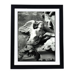 "Framed Original Photograph: Grace - Brought to us by Bay Area photographer Nancy Manning, this weathered angel is calm, graceful and soothing. Note from the Artist: ""I Found this angel in a church in Arles, France.""  Now she is available to grace your own home. Framed, this print is ready to adorn your walls. Please allow three weeks for this item to ship. This image is available in other sizes, both framed and unframed. Please contact Support for assistance with special orders."
