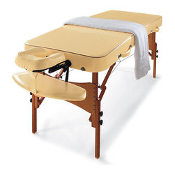 """Frontgate - Portable Massage Table - Six-position face cradle. Auto-Lock™ hardwood legs with a high-gloss Dura-Seal™ dark brown finish. Leg-lock knobs and duo-plane hinges provide stability. Fully assembled. Easy to transport in the included carrying case. Our exclusive, professional-grade Memory Foam Massage Table features luxurious Fine Italia upholstery that provides the look and feel of Italian leather to aid and enhance your relaxation.  . Auto-Lock hardwood legs with a high-gloss Dura-Seal dark brown finish. .  .  . Dimensions when folded into carrying case are 9""""W x 36""""L x 29""""H. Comes with mood CD and 100 disposable face pillow covers. 1,500 lb. weight capacity . Imported ."""