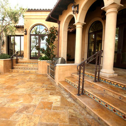 Mediterranean Villa - Tuscany Gold Versailles Pattern travertine is used for exterior flooring.  Hand-painted Malibu tiles were used to add color and pattern to the risers.