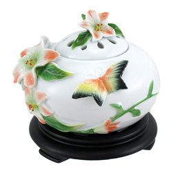 Porcelain Butterfly and Azalea Electric Oil Diffuser Accent Lamp - This electric oil warmer is a beautiful accent to any home! Not only is it visually stunning, it is a safe alternative to traditional oil warmers that use candles to heat the oil or wax cubes. This porcelain lamp measures approximately 5 inches tall, 5 inches in diameter, and is adorned with hand painted azalea flowers and a butterfly. The 5 foot long white power cord has an on/off dial that allows you to adjust the intensity of the light and fragrance to your liking, and it uses a nightlight style bulb (included). The lamp has a diffuser lid, and comes packaged in a gift box.