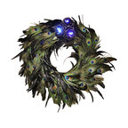The Firefly Garden - Mad Haberdashery - Illuminated Floral Design, Large - Add a splash of blue to your home with a beautiful wreath of peacock feathers. This playful departure from traditional evergreen decor, featuring blue and iridescent peacock feathers is illuminated with tiny blue LED lights which uses3 replaceable AA batteries . The arrangement features stunningly illuminated black roses.