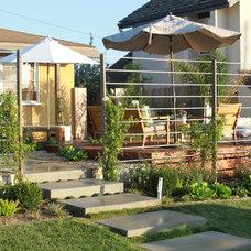 Beach Style  by Living Gardens Landscape Design