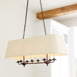 Ballard Designs - Remington 8-Light Rectangle Chandelier - Crafted of iron. Cream drip candle sleeves. Two triple candle arm clusters plus two center lights peek out beneath the soft rectangular cream fabric shade for a cozy glow. The hand applied finish and decorative hanging chain lend a classic look and feel. Paired with a cream 100% cotton shade.Remington 8-Light Chandelier features: . .