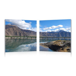 """Wholesale Interiors - Causeway through the Mountains Mounted Photography Print Diptych - Take the scenic route every time: driving along this causeway with its grand backdrop makes for quite the pleasant commute. This modern photography wall art set takes a single image and displays it across two pieces of waterproof vinyl canvas atop MDF wood frames. Manufactured and fully assembled in China, the Causeway through the Mountains mounted photo is ready to hang but does not include hardware needed to hang on a wall. To clean, wipe with a dry cloth. Product dimension: 19.68""""W x 1""""D x 19.68""""H."""