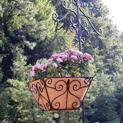 Panacea Products - 12'' Black Fleur-de-Lis Basket - Display your gorgeous plants with this hanging basket that offers a sturdy steel construction, a graceful fleur-de-lis motif and a coco liner for cultivating lush, hearty blooms.   Includes planter and coco liner 12'' W x 12'' H x 7'' D Steel Imported