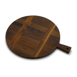 "French Paddle - Walnut - This French style board can be used for kitchen prep as well as a serving board for cheese. Two cross-running tines on the back keep this handmade walnut board from warping due to humidity, so you can enjoy this rustic modern design for years to come. Made from reclaimed walnut, 12"" round."