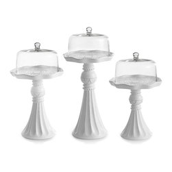 None - Ceramic Cake Pedestals with Glass Dome Covers (Set of 3) - Display your bakery creations on this pedestal cake plate set from American Atelier. The set includes three ceramic pedestal plates and three elegant glass domes.