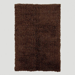 World Market - Cocoa Brown Flokati Wool Rug - Flokati rugs have been a Greek tradition since the 5th century, and our Cocoa Brown Flokati Wool Rug is a prime example. Originating high up in the Pindos Mountains, and made from thick sheep's wool, shepherds used the Flokati for clothing and sleeping during cold winter months. Our durable version offers a natural decorating solution for those looking to add great comfort and style to their space.