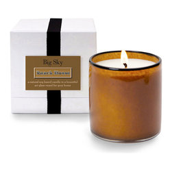 House and Home Big Sky / Ranch House Candle - An inviting fragrance as fresh as the big outdoors suffuses the House and Home Big Sky/Ranch House Candle. Housed in an amber art glass vessel the color of newly turned land, the candle emits a clean and woody scent that is a delightful mix of sagebrush, amber wood, and country air.